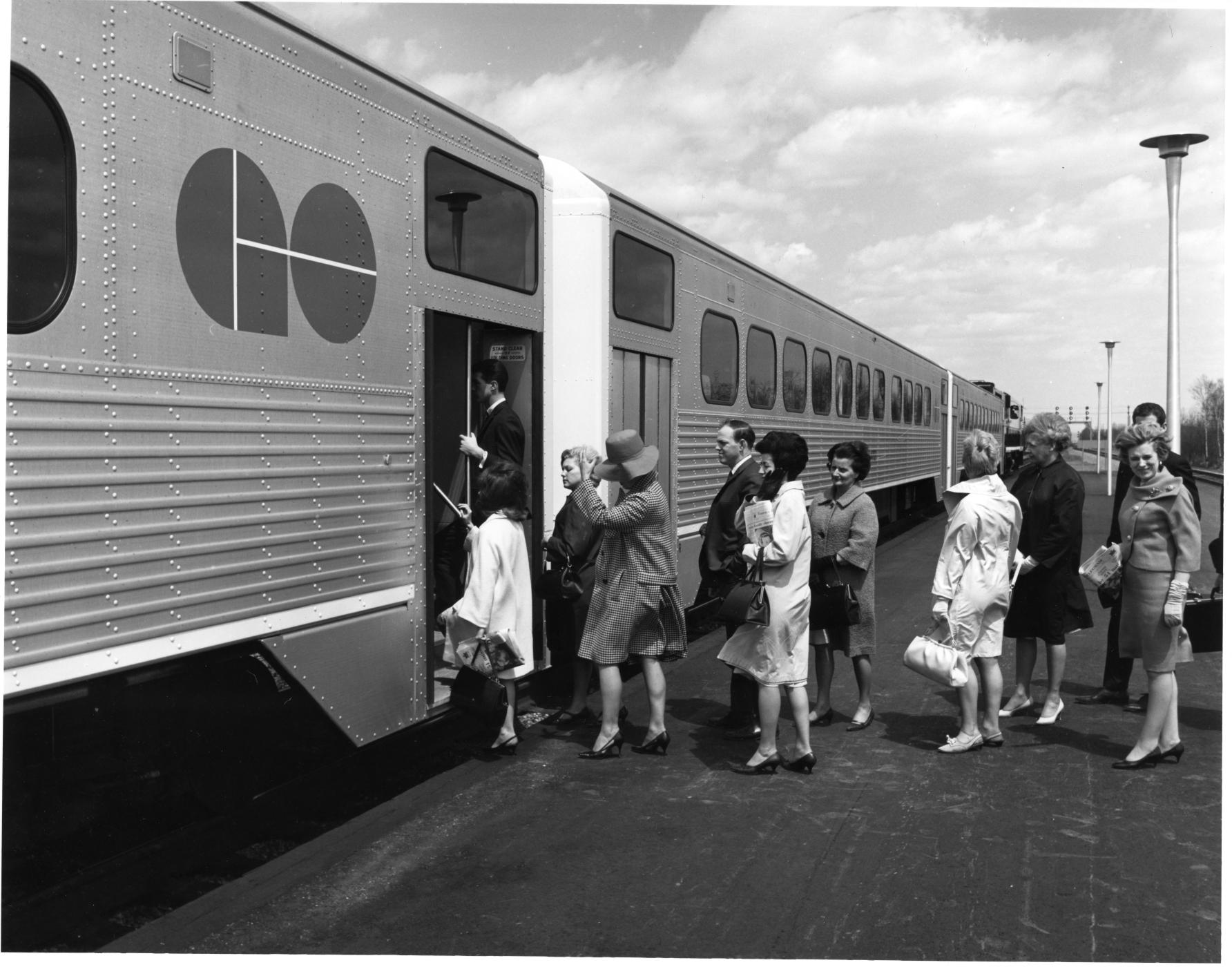 Customers boarding a GO train in the 1960s when GO trains were still single leve